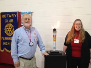 "Farmington Rotary Club President Phil Abraham and long-time rotarian Ginger Barrons with the ""polio"" torch, which is passed from event to event throughout the world. It was in Farmington in 2015. (Photo: Submitted)"